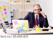 Купить «Aged man employee in conflicting priorities concept», фото № 30695831, снято 25 декабря 2018 г. (c) Elnur / Фотобанк Лори