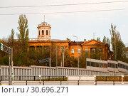 Купить «old house with a tower in the city of Volgograd», фото № 30696271, снято 27 апреля 2019 г. (c) Владимир Арсентьев / Фотобанк Лори