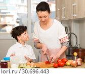 Купить «Woman and her son preparing food», фото № 30696443, снято 28 марта 2019 г. (c) Яков Филимонов / Фотобанк Лори