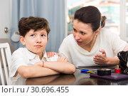 Купить «Frowning tweenager listening mother», фото № 30696455, снято 28 марта 2019 г. (c) Яков Филимонов / Фотобанк Лори