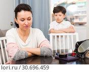 Купить «Offended mother after disagreements with son», фото № 30696459, снято 28 марта 2019 г. (c) Яков Филимонов / Фотобанк Лори