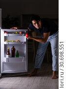 Купить «Man breaking diet at night near fridge», фото № 30698551, снято 8 февраля 2019 г. (c) Elnur / Фотобанк Лори