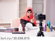 Купить «Beauty blogger in hijab recording video for her blog», фото № 30698815, снято 5 февраля 2019 г. (c) Elnur / Фотобанк Лори