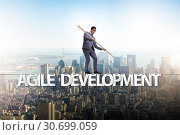 Купить «Agile transformation concept with businessman walking on tight r», фото № 30699059, снято 2 июня 2020 г. (c) Elnur / Фотобанк Лори