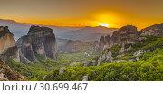 Купить «Panoramic view of the monasteries of Meteora at sunset», фото № 30699467, снято 4 июля 2018 г. (c) Sergii Zarev / Фотобанк Лори