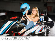 Купить «Woman sitting in go-kart car», фото № 30700167, снято 22 октября 2019 г. (c) Яков Филимонов / Фотобанк Лори