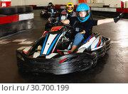 Купить «People driving go-kart cars», фото № 30700199, снято 18 марта 2019 г. (c) Яков Филимонов / Фотобанк Лори