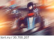Купить «Female racer in helmet driving kart on track», фото № 30700207, снято 18 марта 2019 г. (c) Яков Филимонов / Фотобанк Лори