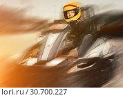 Купить «Girl driving kart at racing track outdoors», фото № 30700227, снято 18 марта 2019 г. (c) Яков Филимонов / Фотобанк Лори