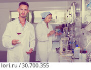 Купить «Attentive glad man testing wine qualities», фото № 30700355, снято 12 декабря 2019 г. (c) Яков Филимонов / Фотобанк Лори