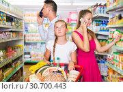 Купить «frustration kid and parents with phones», фото № 30700443, снято 11 июля 2017 г. (c) Яков Филимонов / Фотобанк Лори