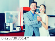 Купить «Glad family couple looking at modern kitchen», фото № 30700471, снято 15 июня 2017 г. (c) Яков Филимонов / Фотобанк Лори