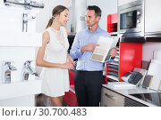 Купить «Smiling assistant working with customer in store», фото № 30700483, снято 15 июня 2017 г. (c) Яков Филимонов / Фотобанк Лори