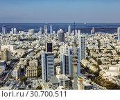 Купить «Top view of Tel Aviv from the observation deck of the round tower Azriel center, Israel», фото № 30700511, снято 16 октября 2017 г. (c) Наталья Волкова / Фотобанк Лори