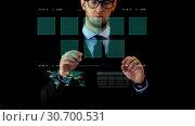 Купить «businessman working with data on virtual screen», видеоролик № 30700531, снято 26 января 2020 г. (c) Syda Productions / Фотобанк Лори