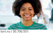 Купить «portrait of smiling african woman at office», видеоролик № 30700551, снято 30 мая 2020 г. (c) Syda Productions / Фотобанк Лори