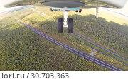 Купить «Helicopter Flies Over A Forest Thicket On A Sunny Summer Warm Day», видеоролик № 30703363, снято 14 сентября 2017 г. (c) Pavel Biryukov / Фотобанк Лори