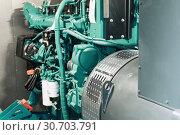 Купить «Fragment of diesel generator module. Emergency power system», фото № 30703791, снято 17 апреля 2018 г. (c) Андрей Радченко / Фотобанк Лори