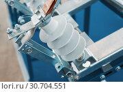Купить «High voltage electrical connector. Metal fittings and ceramic insulators», фото № 30704551, снято 17 апреля 2018 г. (c) Андрей Радченко / Фотобанк Лори