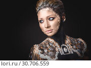 Купить «Portrait a girl with Golden icon painting makeup», фото № 30706559, снято 5 апреля 2019 г. (c) Sergii Zarev / Фотобанк Лори