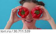 Woman holds pepper in her hands like eyes. Стоковое видео, видеограф Ekaterina Demidova / Фотобанк Лори