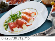 Купить «Rolls of iberian jamon stuffed with melon at plate with arugula», фото № 30712715, снято 21 января 2020 г. (c) Яков Филимонов / Фотобанк Лори