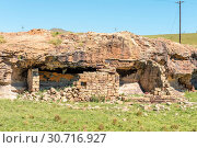 Купить «Ruin of a shelter, built underneath a rock overhang», фото № 30716927, снято 28 марта 2018 г. (c) easy Fotostock / Фотобанк Лори