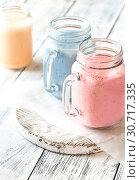 Купить «Berry smoothies on the wooden board», фото № 30717335, снято 17 июня 2018 г. (c) easy Fotostock / Фотобанк Лори