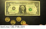 One green US dollar price of 6 gold Russian coins of 10 rubles. Стоковое видео, видеограф Aleksandr Sulimov / Фотобанк Лори