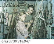 Купить «Woman teacher assisting student during painting class», фото № 30718947, снято 21 августа 2019 г. (c) Яков Филимонов / Фотобанк Лори