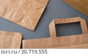 Купить «disposable paper bags», видеоролик № 30719555, снято 5 мая 2019 г. (c) Syda Productions / Фотобанк Лори