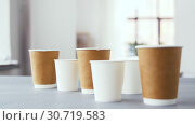 Купить «various disposable paper cups for hot drinks», видеоролик № 30719583, снято 5 мая 2019 г. (c) Syda Productions / Фотобанк Лори