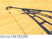 Купить «Oil pump shadow on dry ground. Oil and gas industry. Ecological problems concept. Global warming.», фото № 30723995, снято 7 июля 2017 г. (c) bashta / Фотобанк Лори