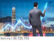 Купить «Businessman in stock trading concept», фото № 30725703, снято 21 сентября 2019 г. (c) Elnur / Фотобанк Лори