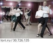 Купить «Couples enjoying latin dances», фото № 30726135, снято 4 октября 2018 г. (c) Яков Филимонов / Фотобанк Лори