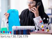 Купить «Female chemist in hijab working in the lab», фото № 30726179, снято 20 февраля 2019 г. (c) Elnur / Фотобанк Лори