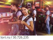 Купить «people looking laser guns and clothes together», фото № 30726235, снято 23 августа 2018 г. (c) Яков Филимонов / Фотобанк Лори