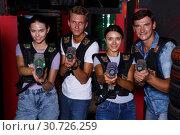 Купить «Group portrait of happy people with laser guns», фото № 30726259, снято 23 августа 2018 г. (c) Яков Филимонов / Фотобанк Лори