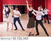 Купить «Couples enjoying latin dances», фото № 30726343, снято 24 мая 2017 г. (c) Яков Филимонов / Фотобанк Лори