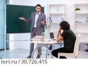 Купить «Young teacher and student in the classroom», фото № 30726415, снято 22 февраля 2019 г. (c) Elnur / Фотобанк Лори