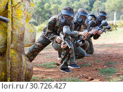 Купить «Portrait of team of adult people playing on paintball battlefield outdoor», фото № 30726427, снято 22 сентября 2018 г. (c) Яков Филимонов / Фотобанк Лори