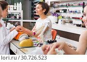 Купить «Manicure masters working», фото № 30726523, снято 28 апреля 2017 г. (c) Яков Филимонов / Фотобанк Лори
