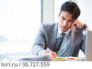 Купить «Young successful businessman working at the office», фото № 30727559, снято 6 августа 2018 г. (c) Elnur / Фотобанк Лори