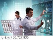 Купить «Doctor in telemedicine concept looking at x-ray image», фото № 30727835, снято 23 мая 2019 г. (c) Elnur / Фотобанк Лори