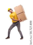 Купить «Young male courier with box», фото № 30727899, снято 9 ноября 2018 г. (c) Elnur / Фотобанк Лори