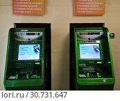 Купить «Банкоматы в отделении Сбербанка», фото № 30731647, снято 30 марта 2019 г. (c) Victoria Demidova / Фотобанк Лори