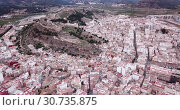 Купить «Aerial view of Sagunto city and antique roman fortress, Valencia, Spain», видеоролик № 30735875, снято 19 марта 2019 г. (c) Яков Филимонов / Фотобанк Лори
