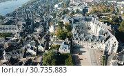 Купить «View from drone of French city of Blois with Royal Chateau and church of St. Nicolas in sunny autumn day», видеоролик № 30735883, снято 25 октября 2018 г. (c) Яков Филимонов / Фотобанк Лори