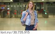 Купить «Blonde with long hair passing the turnstiles at subway station», видеоролик № 30735915, снято 25 апреля 2019 г. (c) Яков Филимонов / Фотобанк Лори