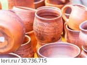 Купить «Pottery mugs closeup. Exhibition sale.», фото № 30736715, снято 10 августа 2018 г. (c) Акиньшин Владимир / Фотобанк Лори